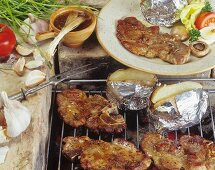 Pork neck with baked potatoes on the barbecue