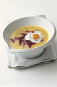 Potato soup with beetroot and fried quail's egg