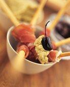 Grissini e prosciutto (grissini wrapped in ham)