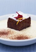 A piece of beetroot chocolate cake on ginger sabayon