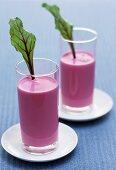 Beetroot yoghurt drink garnished with beetroot leaves