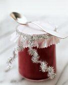 A jar of cranberry curd