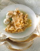 Crepes with apple filling and cider sauce