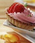 Strawberry mousse tartlet, garnished with fresh strawberry