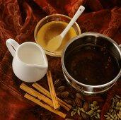 Yogi tea (Ayurvedic spiced tea), milk and honey beside it