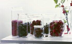 Fresh berries in bottling jars