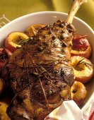 Leg of lamb with pistachios and rosemary peaches