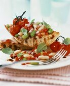 Toasted bread with bean salad and cocktail tomatoes