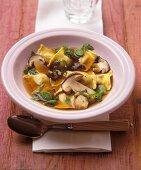 Cep broth with mushroom ravioli