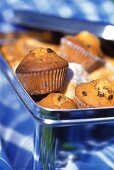 Chocolate chip muffins and donuts in a tin