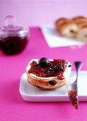 Raisin buns with blackberry jam