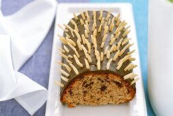Rehrücken cake (chocolate roll) with slivered almonds