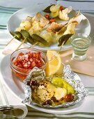 Goat's cheese with olives & chillies & cheese fondue on skewer