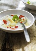 Creamed asparagus soup with tomatoes, lemon grass and chili
