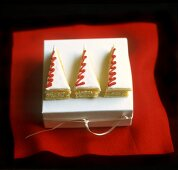 Marzipan-coated pieces of sponge cake in shape of Xmas tree