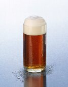 Altbier with head of foam in a glass
