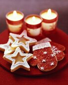 Star- and glove-shaped biscuits with three candles