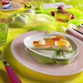 Colourful vegetables in aspic on table laid for Easter
