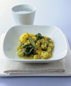 Chick-pea and broad bean dhal with caraway potatoes