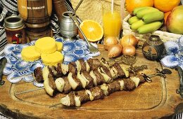 Grilled meat kebabs, corn cakes and mate (Paraguay)