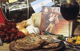Fried beef steaks with wine and decorative items (Argentine)