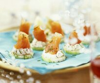 Salmon with soft cheese on cucumber slices