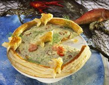 Fish tart with shrimps, decorated with puff pastry fish