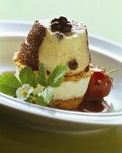 Chocolate pudding on champagne ice cream between cake bases