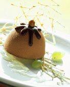 Hazelnut gianduja parfait with grapes in mead sauce