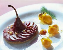 Tart with red wine pears and candied kumquats