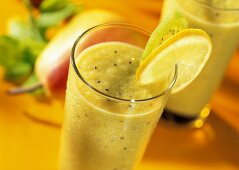 Totally twisted: kiwi & vegetable drink in glass with lemon
