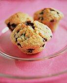 Three blueberry yoghurt muffins on glass plate