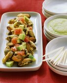 Mussel and avocado salad with diced tomatoes
