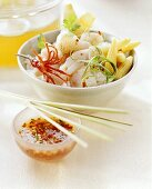 Thai-style fish fondue with rice and chili sauce; stock