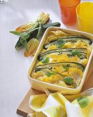 Courgette and pasta bake with fresh basil in baking dish