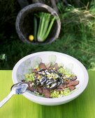 Cucumber and celery salad with roast beef and anchovies