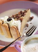 Coffee charlotte with cream and chocolate mocha beans
