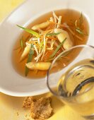 Consomme with asparagus, strips of vegetable & fresh tarragon