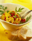 Hummus with sesame, diced paprika and white bread