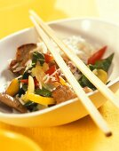 Pork fillet with chard and peppers on rice