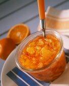 Peach and orange preserve in preserving jar