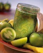 Green tomato preserve in preserving jar