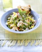 Colourful rocket salad with mushrooms and caper apples