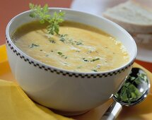 Yellow pepper soup with herb leaves