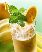 Fruit shake with banana ice cream and lemon balm
