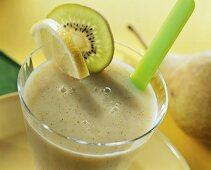 Pear and kiwi fruit drink with slice of lemon & kiwi fruit