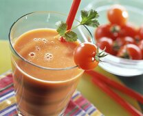 Spicy tomato drink garnished with cherry tomato