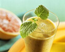 Grapefruit and lemon balm drink with fresh lemon balm