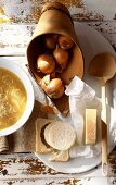 Onion soup with ingredients (onions, white bread, cheese)