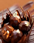 Diamond-shaped filled chocolates with gold leaf